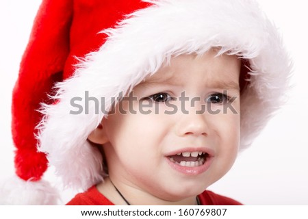 little sad santa portrait on white - stock photo
