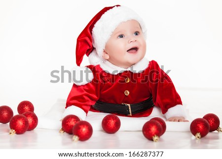 little santa baby with christmas hat lying over white background - stock photo
