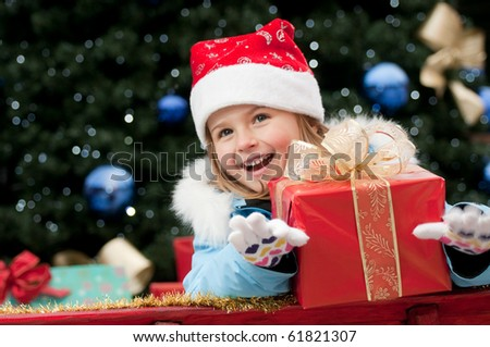 Little Santa Claus with Christmas presents - stock photo