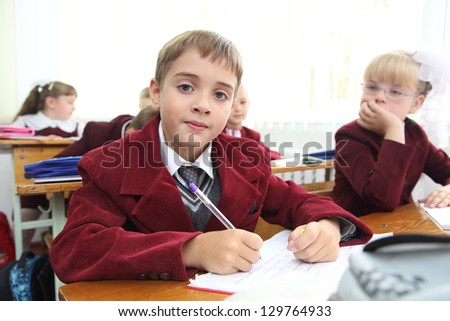 Little schoolboy in Ukrainian school - stock photo