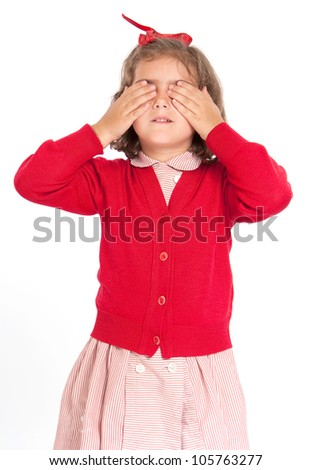 Little schoolgirl with a red uniform covering her eyes - stock photo