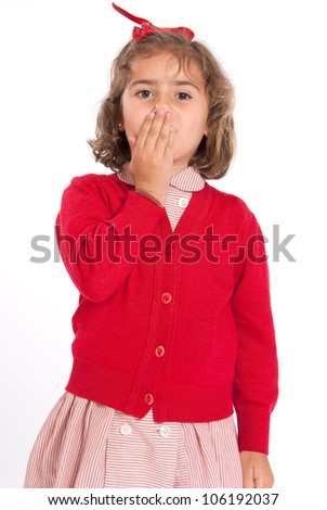 Little schoolgirl with a red uniform covering her mouth - stock photo