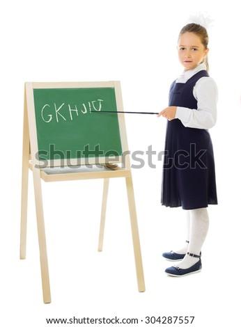 Little schoolgirl with blackboard isolated on white - stock photo