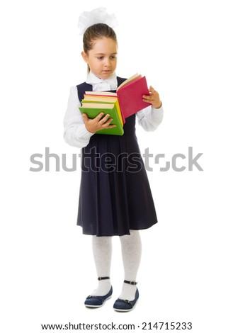 Little schoolgirl with books isolated - stock photo