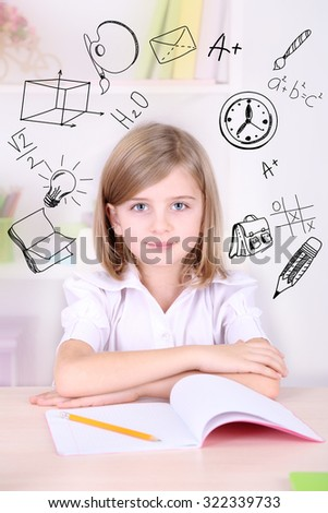 Little schoolgirl  with school  icons - stock photo
