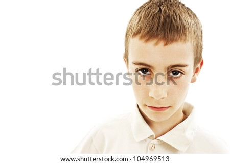 Little serious boy portrait on white background - stock photo