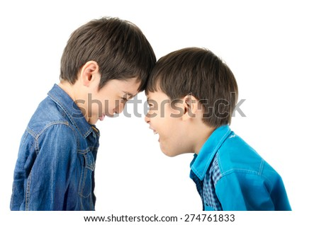 Little sibling boy fighting brother on white background - stock photo