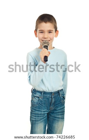 Little singer boy with microphone against white background - stock photo