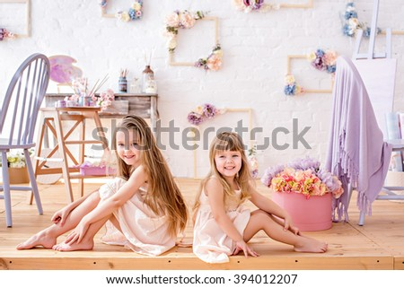Little sister of the artist in a floral studio easel - stock photo