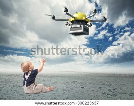 little sit child look modern drone - stock photo