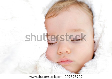 little sleeping baby in a white blanket - stock photo
