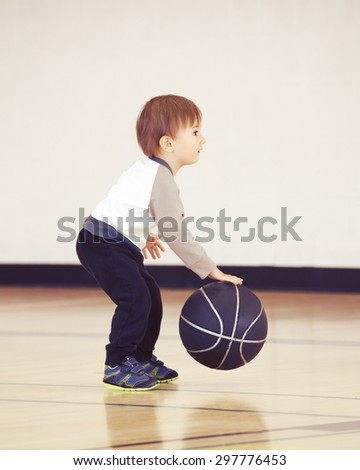 Little small child toddler boy playing with ball in gym, having fun, healthy lifestyle childhood concept, copyspace for text - stock photo
