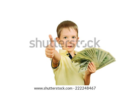 little smiling boy holding a a stack of 100 US dollars bills and showing thumb up. isolated on white background. horizontal - stock photo