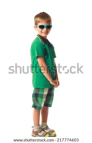 Little smiling boy with blue sunglasses isolated on white background - stock photo