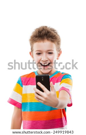 Little smiling child boy hand holding mobile phone or smartphone making selfie portrait photo white isolated - stock photo