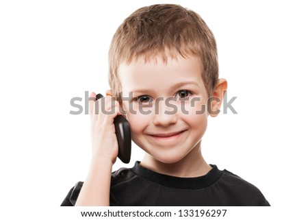 Little smiling child boy hand holding mobile phone or smartphone white isolated - stock photo