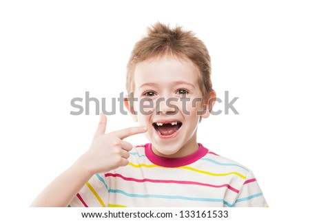 Little smiling child boy hand pointing his first baby milk or temporary teeth fall out - stock photo