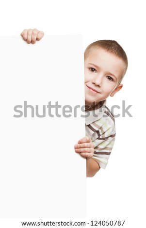 Little smiling child boy holding blank white sign or placard - stock photo