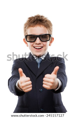 Little smiling child boy in business suit wearing sunglasses hands gesturing thumb up success sign white isolated - stock photo