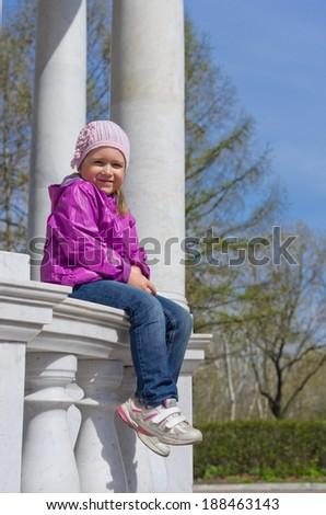 Little smiling girl at park - stock photo