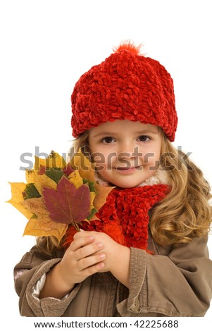 Little smiling girl holding colorful autumn leaves - isolated - stock photo