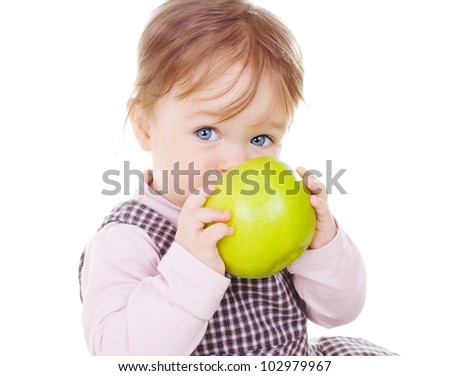 Little smiling girl holding green apple on white background. - stock photo