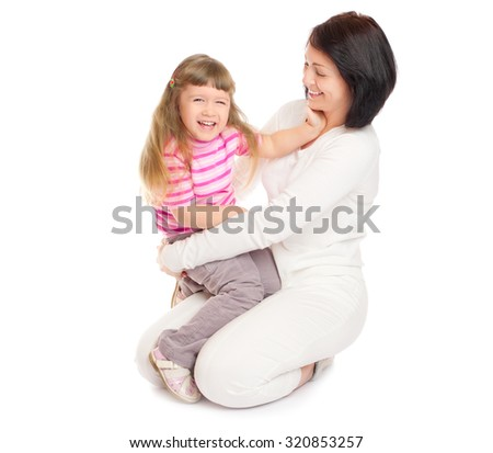 Little smiling girl with mother isolated - stock photo