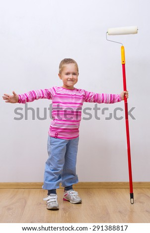 Little smiling girl with painting roller - stock photo