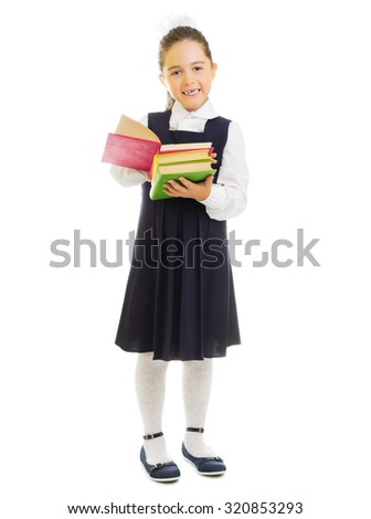 Little smiling schoolgirl with books isolated - stock photo