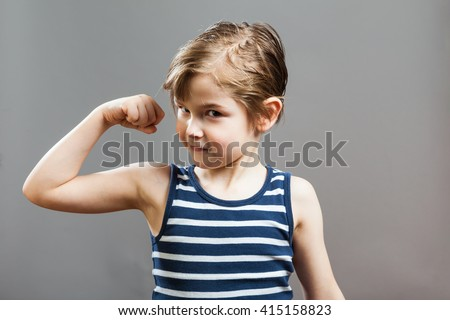 Little Sportive Tough Boy in striped  muscle shirt, showing his muscles, smiling in Camera - stock photo