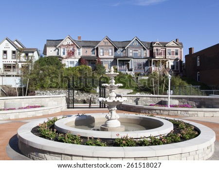 Little square with a fountain in residential district of Saint John town (New Brunswick, Canada). - stock photo