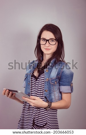 Little  student  while using digital tablet at desk  - stock photo
