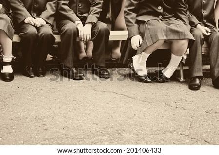 Little students on school meeting - stock photo