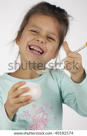 little successful girl eating yogurt - stock photo
