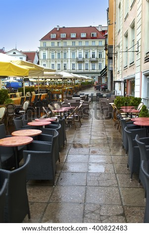 little tables of cafe at Town Hall Square, Tallinn, Estonia - stock photo