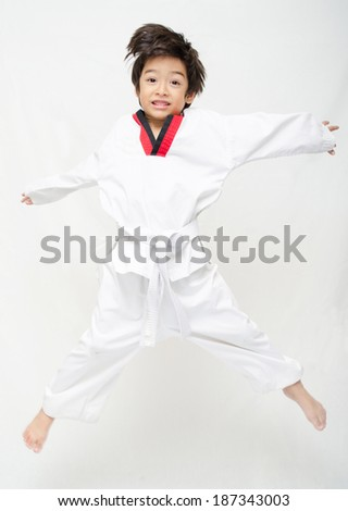 Little tae kwon do boy martial art  jumping  - stock photo