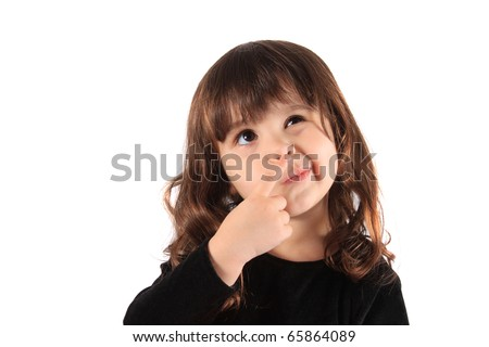 Little three year old brunette little girl holding her hand to her face with a thinking expression, hmm - stock photo