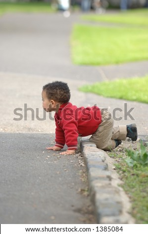 Little Toddler at play in the park - stock photo