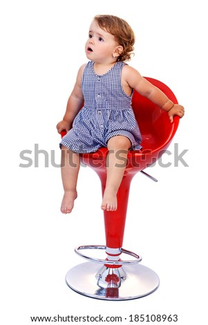 Little toddler girl on tall red bar stool - isolated - stock photo