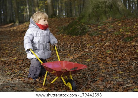 little toddler outdoors in the forest - stock photo