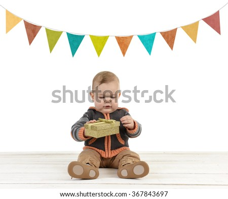 little toddler with gift - stock photo