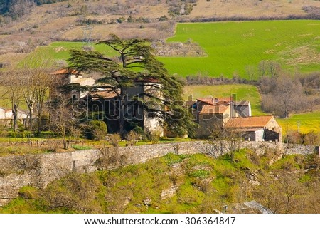 little town and tree in a mountain - stock photo