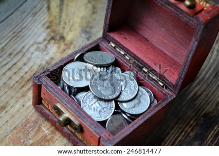 Little treasure chest with american quarter of a dollar cents - stock photo