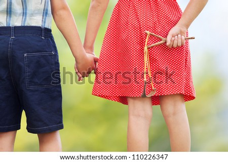 Little trouble makers with slingshot - stock photo