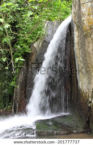 Little waterfall between vegetation in Monte Gelato. Rome, Italy - stock photo