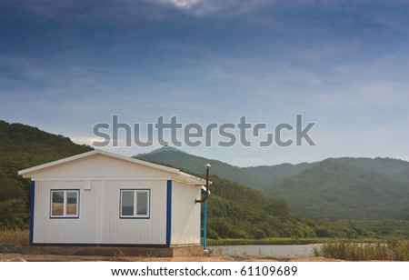 little white house to relax in the azure lake - stock photo