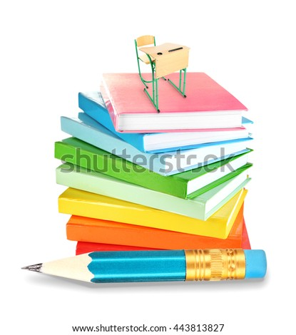 Little wooden desk and chair on stack of books and big pencil isolated on white - stock photo