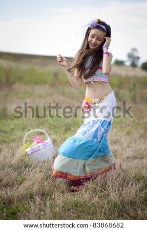 little 8 years girl in summer dress walking on the natural background - stock photo