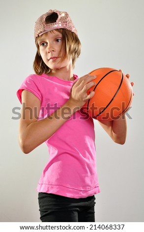 little 10 years old  girl exercising with a ball - stock photo
