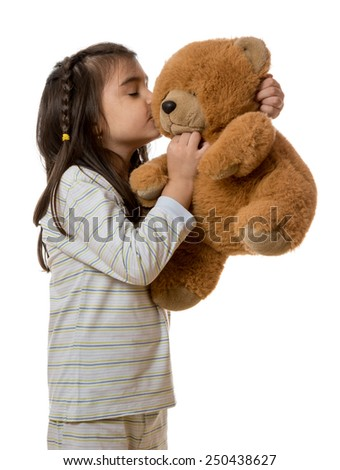 little young girl holding teddy bear on white background - stock photo